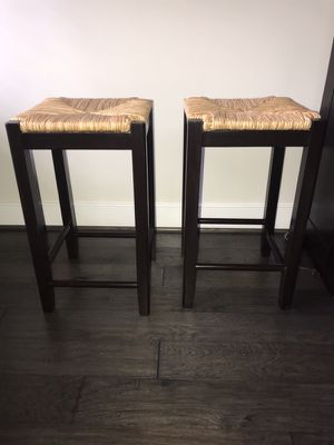 Two brown wooden rushed-seat stools (counter height) for Sale in Alexandria, VA