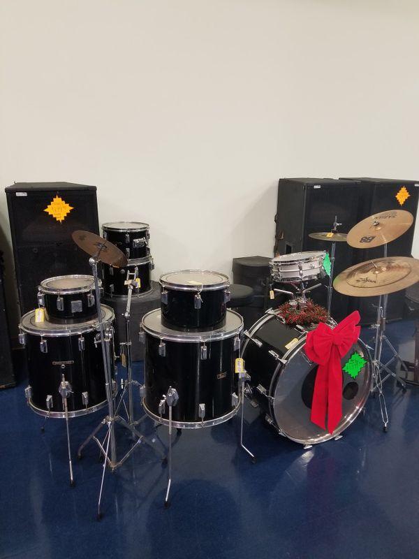 Pearl fiber glass shell drum set.