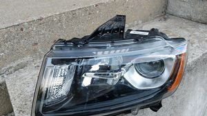 2015 Jeep Grand Cherokee driver side headlight for Sale in Westfield, MA