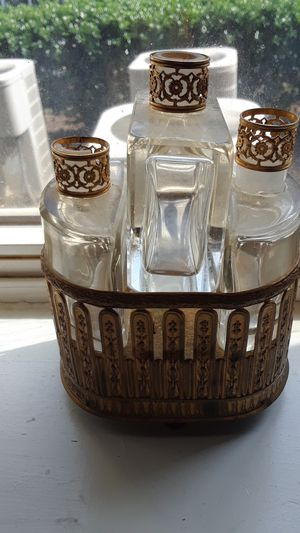 Antique perfume holder holding 3 bottles. Base is a music box. for Sale in Taylors, SC