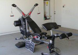 Bowflex Revolution Flex Spiraflex Home Gym System w/ extra weights for Sale in Washington, DC