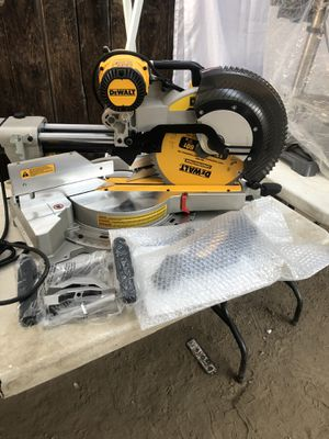 DEWALT 15 Amp Corded 12 in. Double Bevel Sliding Compound Miter Saw with XPS technology, Blade Wrench & Material Clamp for Sale in La Habra, CA