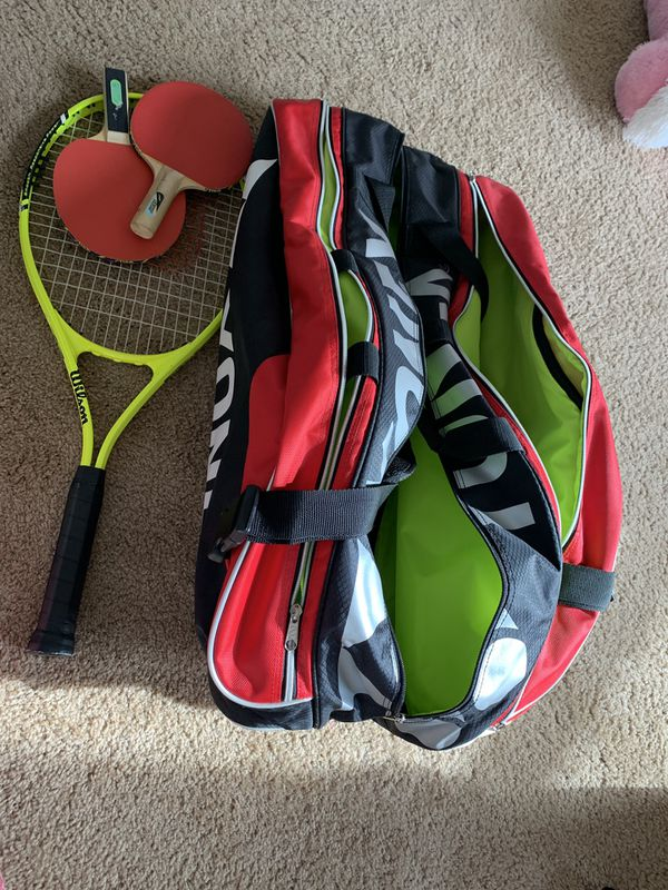 Badminton big bag and tennis racket and table tennis racquets.
