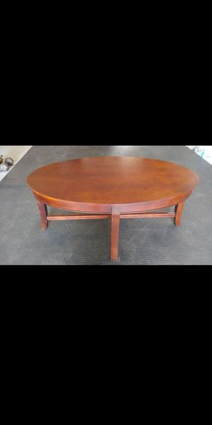 Oval shaped coffee table. This table measure 20 inches high by 47.5 inches long by 28 inches wide. Must pick up for Sale in Olympia, WA