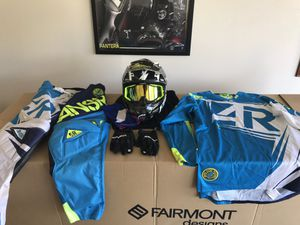 Fly helmet size medium , Answer jersey (XL) and pants (size 34), size large Seven gloves , and 100% goggles for dirt biking. for Sale in Orange, CA
