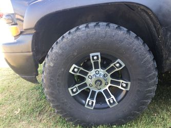 I have some 17 inch rims six lug and tires for trade for some 20 inch rims black for Sale in Lexington,  NC