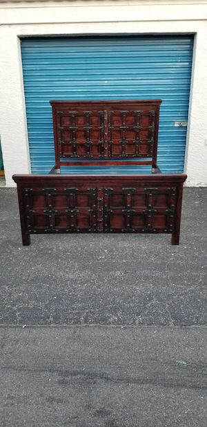 Solid wood queen size bed frame. Very heavy and well made. Support slats are metal for Sale in Phoenix, AZ