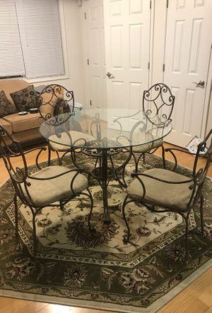 Glass kitchen table with rod iron chairs for Sale in Alexandria, VA