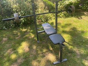 Bench Press Rack + Olympic Barbell + 60 lbs of Weight Plates for Sale in Snohomish, WA