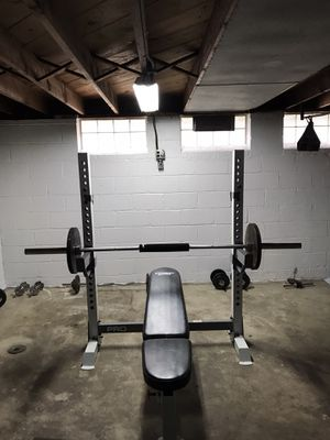 Olympic bench barely used , weight tree and 70 pounds in weight for Sale in Cleveland, OH