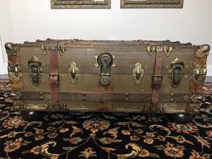 Antique Vintage Steamer Trunk with heavy glass top and optional hardwood bun feet for use as a coffee table. for Sale in North Reading, MA