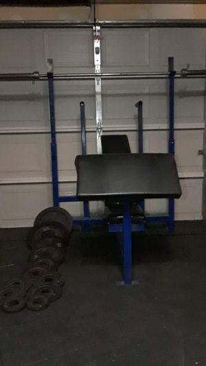 Bench press with dip station preacher curl weights and bar for Sale in Fort Worth, TX