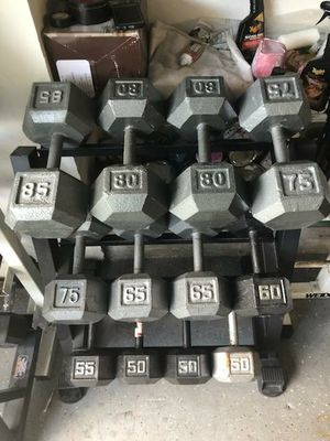 Weights, dumbbells, stands, bars. All weights selling at $0.50 cent a pound. Firm for Sale in Tampa, FL