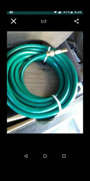 50ft. Garden hose new with nozzle $15.00 for Sale in Los Angeles, CA