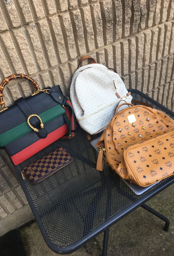 Michael kors , MCM, Gucci hand bag and Louis Vuitton wallet