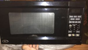 Oster microwave in good condition for Sale in Fairfax, VA