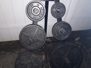 255 lb set of olympic weight plates and olympic plate weight holder for Sale in Baltimore, MD