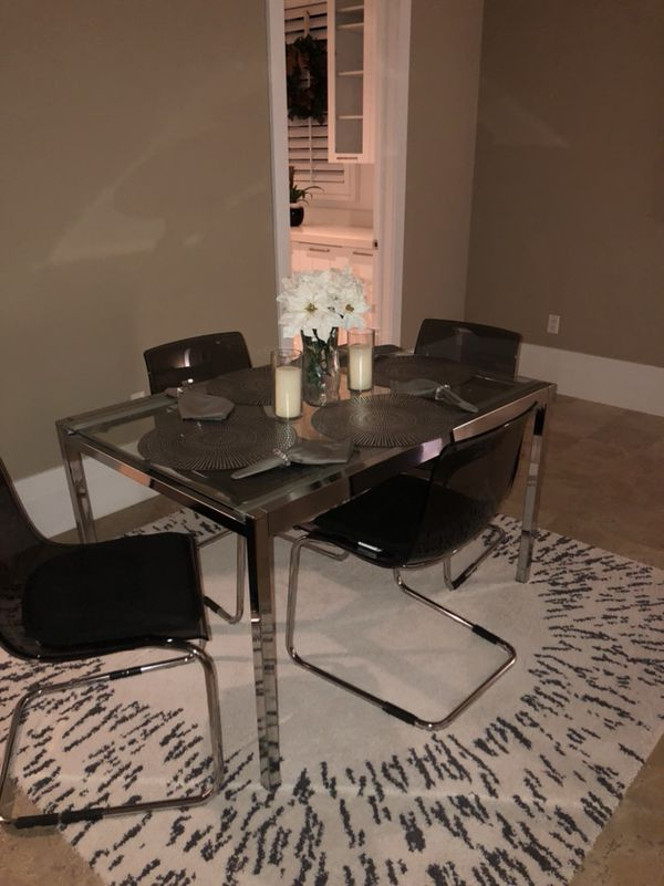 IKEA extendable glass and metal dining table with 4 ...