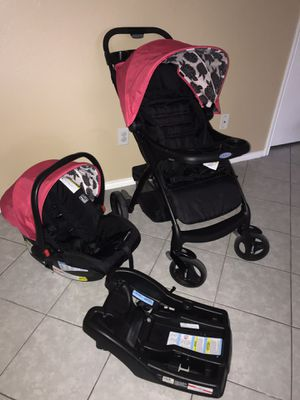 Travel system pink & black / car seat base and stroller for Sale in Brownsville, TX