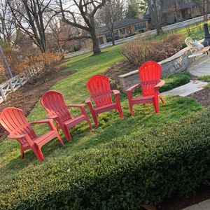 4 red plastic chairs for Sale in Mount Prospect, IL