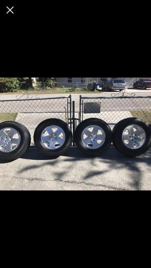 18 inch wheels off a Jeep Wrangler. 255/70r18 tires for Sale in Haines City, FL