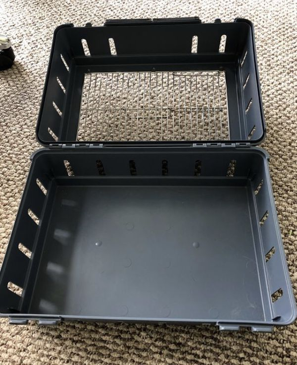 "Hard plastic and metal top. Pet, cat l, dog carrier for airplane cabin. Measures approx 15x11.5x8"". Easy to clean."