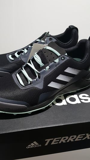 Adidas size 9 women hiking shoe black and pale green for Sale in Peoria, AZ