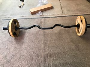 Cap super curl bar with 40Lb Olympic plates for Sale in Phoenix, AZ