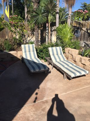 Two unfinished teak chaise lounges with rolling wheels and cushions. .... Must pick up for Sale in El Cajon, CA
