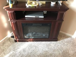 Tv stand with fireplace for Sale in Bridgeport, WV