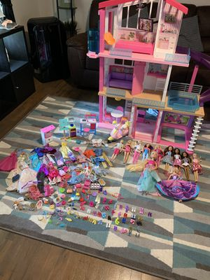 Barbie dream house with barbies and tons of accessories for Sale in Gresham, OR