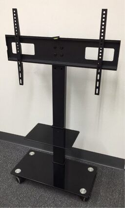 New in box 11x26x43 inches tall 32 to 65 inches tv television stand with wheels 90 lbs capacity for Sale in Los Angeles, CA