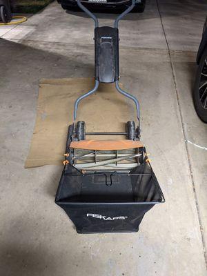 Fiskar reel mower with basket for Sale in Reedley, CA