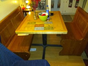 Beautiful corner booth seating bench. Benches open and has center piece. Good condition. for Sale in Enumclaw, WA
