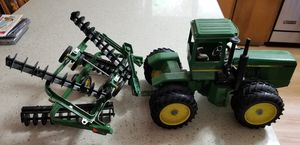 Vintage john deere tractor toy and disc for Sale in Beaverton, OR