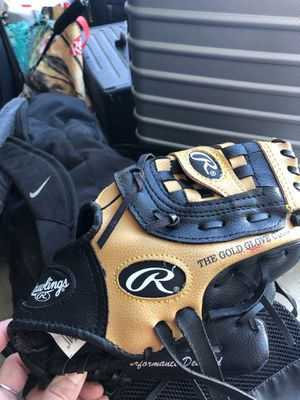Softball gear of all sorts; couple gloves; couple set of cleats; batting gloves; baseball bag for Sale in Chino Hills, CA