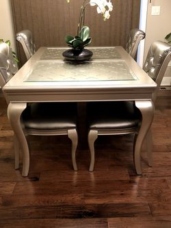 **BRAND NEW**Dining table with 2 glass inserts-W/leaf & 6 total Chairs—New**STILL IN BOXES! for Sale in Goodyear,  AZ