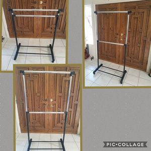 Rolling clothes rack for Sale in GARDEN GROVE, CA
