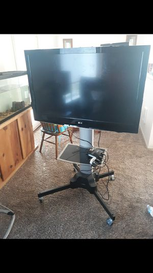 TV and stand for Sale in Puyallup, WA