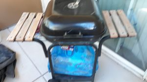 BBQ Grill with two large bags of charcoal unopened and cover for Sale in Las Vegas, NV
