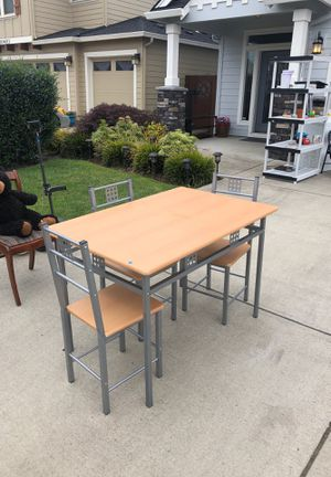 Wood table with metal base and three chairs for Sale in Vancouver, WA