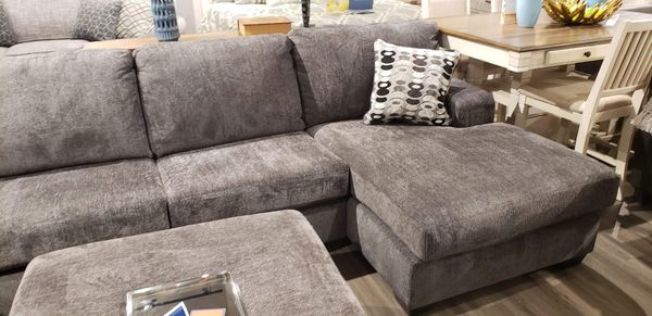 Gray three pieces sectional with chaise