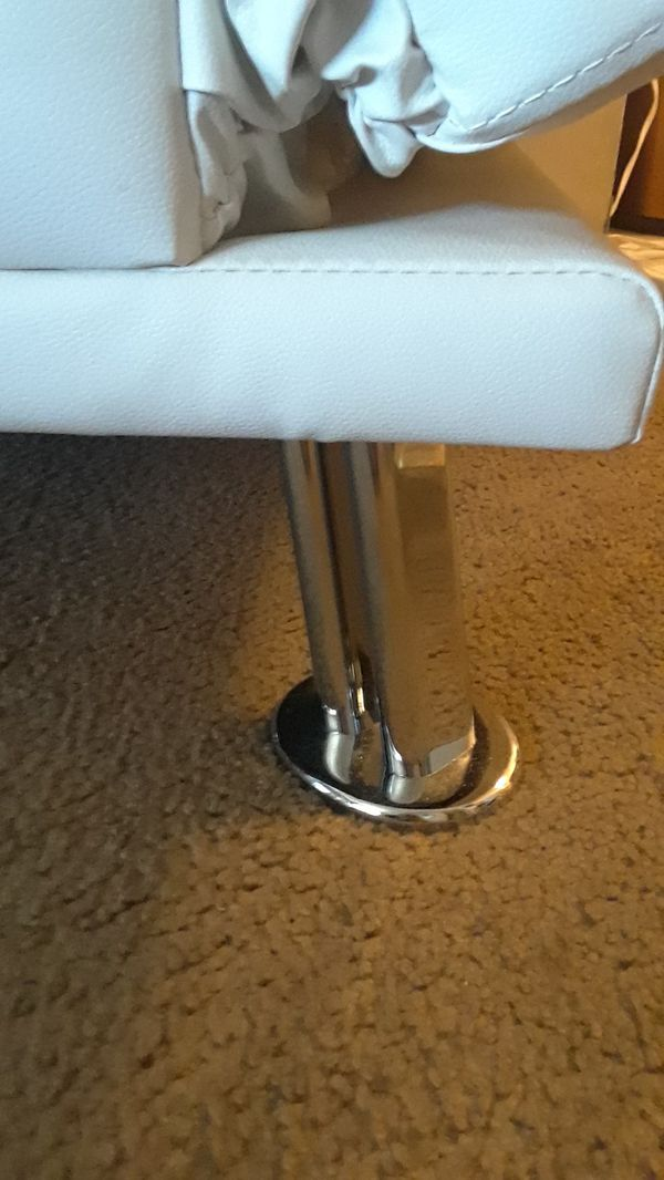 White leather futon adjustable to bed . Brand new