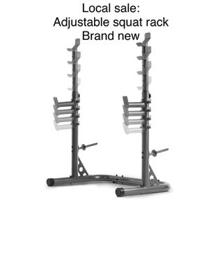 Olympic adjustable squat and bench press rack with weight plate holder pegs brand new in box. Great for exercise lifting fitness workouts and for hom for Sale in Edgewood, WA