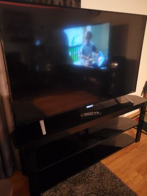 65in Phillips tv & stand for Sale in Pasadena, TX