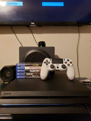 Ps4 pro with wired remote and games(ON HOLD) for Sale in San Bernardino, CA