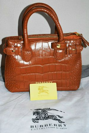 Burberry. Michael kors. Carolina herera for Sale in Falls Church, VA