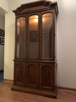 "China cabinet, lighted w/glass shelves on top and a wood shelf on bottom for extra storage. 39""Wx76.1/2""Hx14.1/2""D. for Sale in Indianapolis, IN"