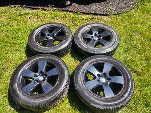 Ram 1500 black stock tire rims for Sale in Dumfries, VA