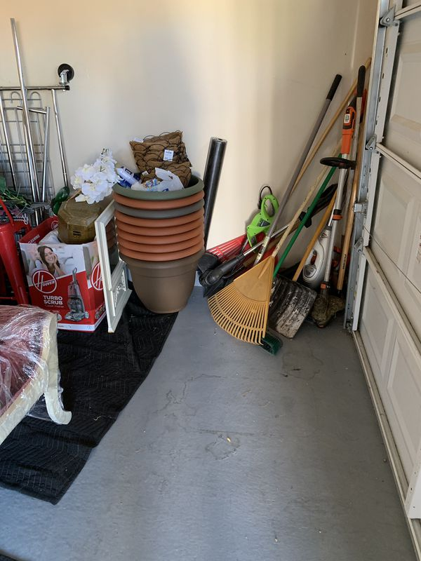 Tons of garden equipment and brand new planter pots.